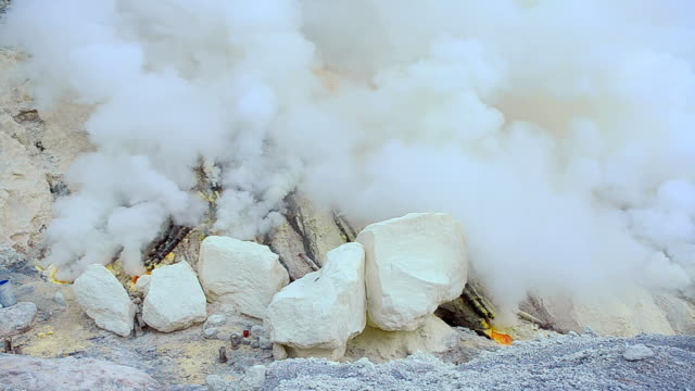 Sulphur Miners Mountain At Ijen Volcano, Indonesia