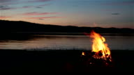 Summer Campfire and Lake at sunset