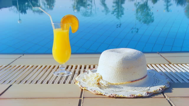 HD DOLLY: Summer Hat And Cocktail By The Pool