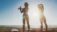 Summer is here: surfer girls ready to surf