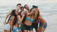 Summer with friends: a group selfie by the sea