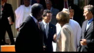 Africa aid pledge criticised GERMANY Heiligendamm EXT Large group of world leaders along with Outreach representatives Leaders gathering on stage for...