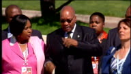 Day 2 arrivals ITALY L'Aquila EXT Manmohan Singh arrival at conference building in golf buggy and walks towards entrance/ Felipe Calderon along/...
