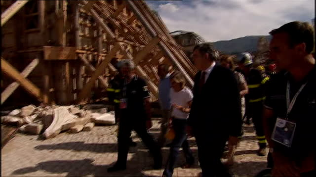 Gordon Brown tours areas destroyed by earthquake in L'Aquila Brown and fire officer surveying earthquake damage / More of Brown and Sarah Brown...