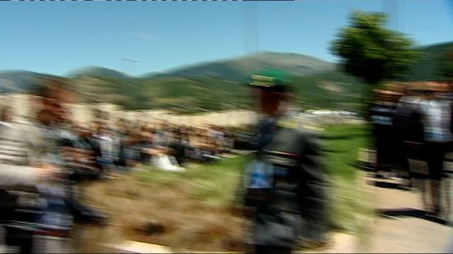 group photocall ITALY L'Aquila Guardia di Finanza EXT Angela Merkel along in 'golf buggy'/ Gordon Brown MP along for group photocall/ Ban KiMoon...