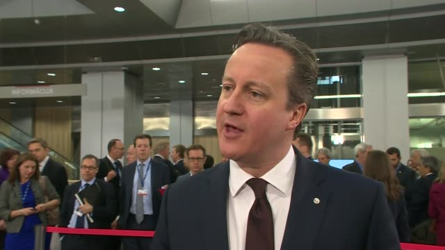 David Cameron arrival and interview LATVIA Riga INT David Cameron MP along towards in summit foyer area/ David Cameron interview SOT hopes and...