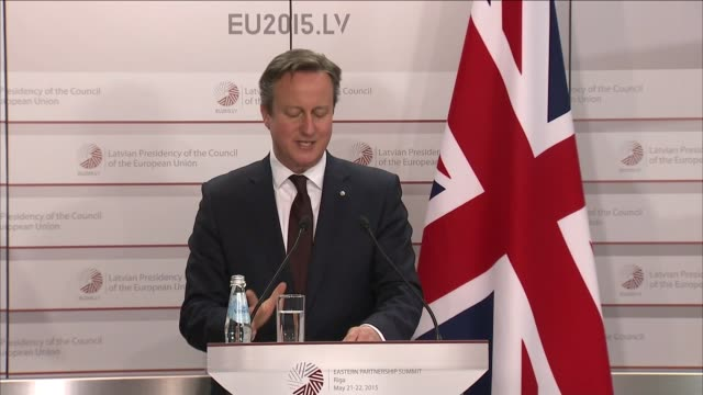 David Cameron press conference in Riga LATVIA Riga INT David Cameron MP into room / David Cameron MP speech about EU reform SOT