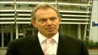 Tony Blair speaking to press on Afghanistan LATVIA Riga EXT Tony Blair MP towards from NATO summit venue to press / Tony Blair MP press conference...