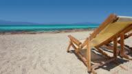 HD: Sun chairs on sandy beach