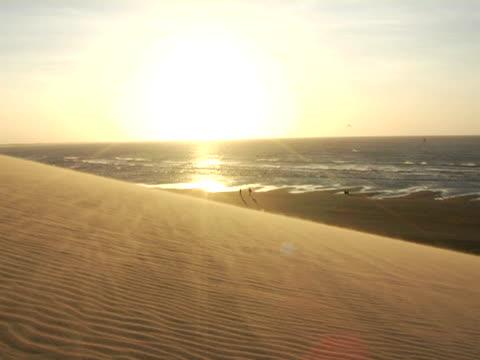 WS, PAN, Sun dune and ocean at sunset, Jericoacoara beach, Brazil