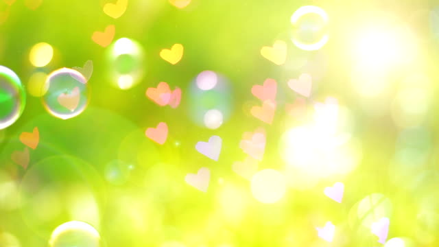 Bokeh Heart Shape Of Light Background Stock Footage Video: Sun Light Heart Shape Bokeh Natural Background Stock