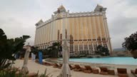 Sun loungers sit beside the wave pool at the Galaxy Macau casino resort operated by Galaxy Entertainment Group Ltd in Macau China on Monday Mar 16...
