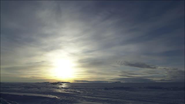 Sun moves across Antarctic landscape