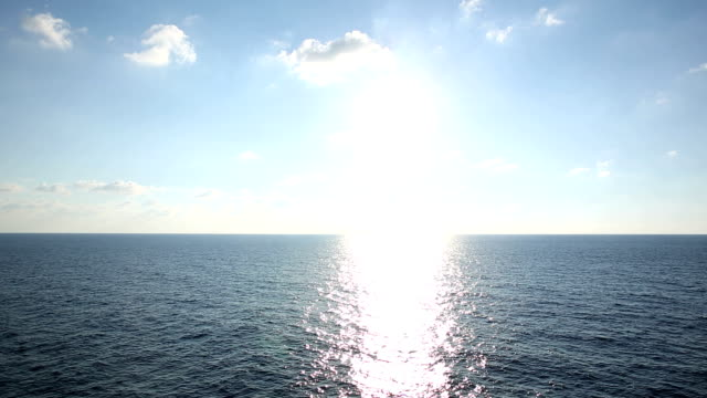 Sun rises above Mediterranean Sea, ship view