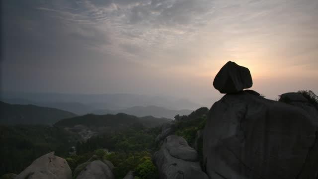 Sun rises over rocky outcrops, Taimu mountain, Fujian, China