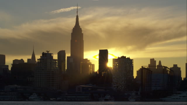 Sun Rising from Behind the Manhattan Skyline