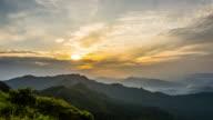 Sun rising over the mountain in morning