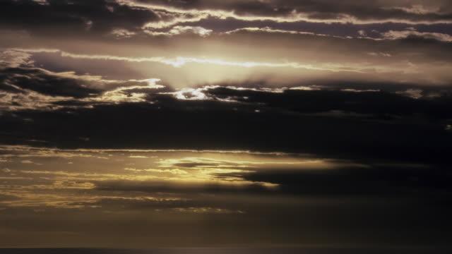 WS ZO T/L Sun rising through clouds / Darwin, Northern Territory, Australia.