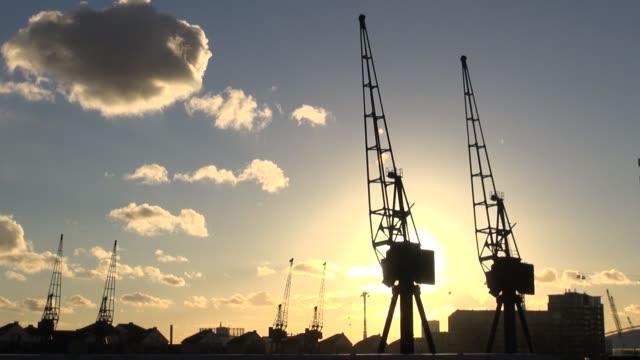 Sun setting behind cranes at Royal Victoria Dock in east London England Sunset at Royal Victoria Docks at Royal Victoria Docks on November 04 2013 in...