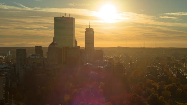 T/L WA HA ZI Sun setting behind downtown skyline  / Boston