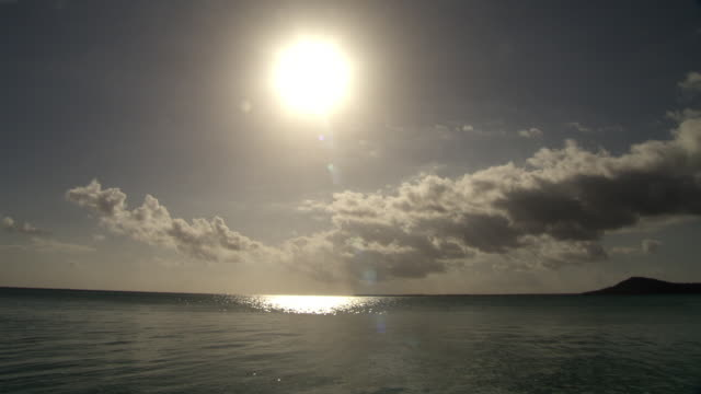 Sun shines over tropical sea, Rangiroa, French Polynesia