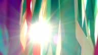 sun shines through the colored ribbons