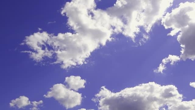 T/L, MS, Sun shining through white fluffy clouds against blue sky, Australia