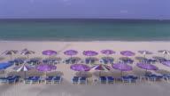 MS, HA, Sun umbrellas and empty beach chairs facing ocean on Kata-Noi Beach, Phuket, Thailand
