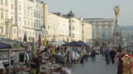 MS Sunday flea market on the Hauptplatz (main square) with the Pestsaule in right center