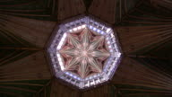 Sunlight floods in through stained glass windows on the walls and in the ceiling of Ely Cathedral. Available in HD.
