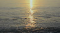Sunlight reflecting on ocean waves at sunrise. Florida.