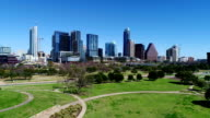 Sunny Aerial Austin Texas Butler Park flying up drone view in early spring