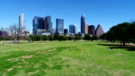Sunny Aerial Austin Texas Butler Park low backing up view