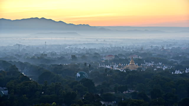 Sunrise behind the mountains at Mandalay hill in Myanmar, time lapse.