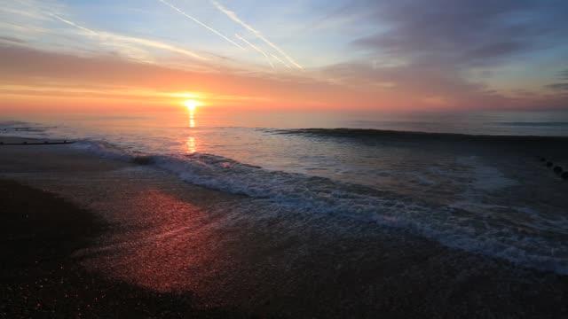 Sunrise colours over the English Channel, Bognor Regis, West Sussex, England, UK
