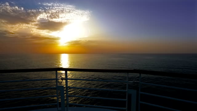 HD sunrise or sunset from a sailing ship bow