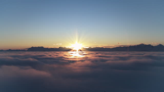 sunrise over fog