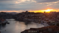 WS sunrise over Historic city of Porto with Ponte Luís I bridge crossing Douro river