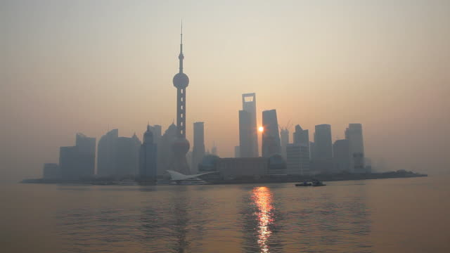 Sunrise over modern Shanghai city, Oriental Pearl Tower, Huangpu River, Pudong district, Shanghai, China, Asia