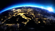 Sunrise over the earth seen from space.Close up of Italy and Europe zone.with night time and sunrise.