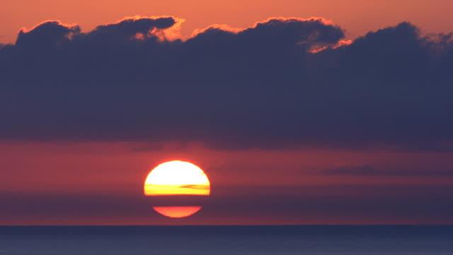 Sunrise through the clouds. Full HD, Progressive.