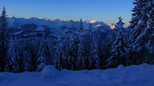 sunrise, winter landscape in mountains