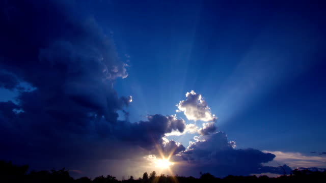 Sunrise with clouds, light rays ,time lapse