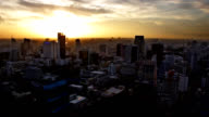WS Sunrise/Sunset time lapse overlooking central Bangkok skyscrapers