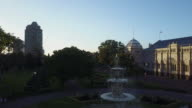 Sunset Aerial view of Carlton Gardens with a fountain and exhibition centre