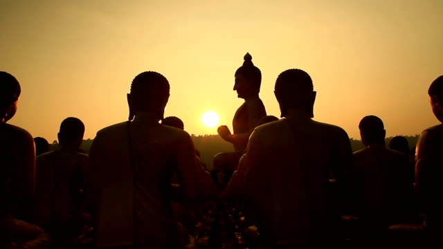 Sunset and silhouette big buddha statue