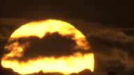 BCU sunset behind clouds