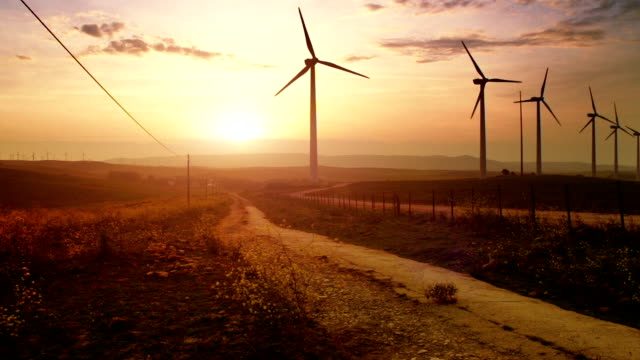 Sunset landscape with wind turbines