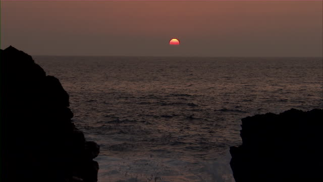 Sunset on Hawaiian coast.