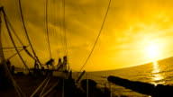 sunset on the bowsprit of the old sailing ship